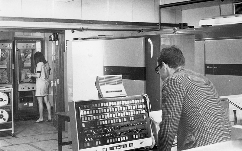 Black and white image of students in lab working on Atlas Supercomputer