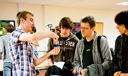 Three prospective students observing an open day demonstration