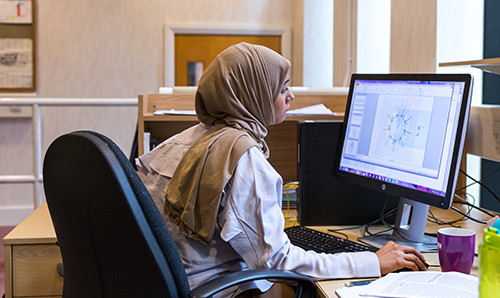 Female student using a computer