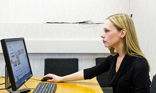 Caroline Jay sitting at a desk using a computer
