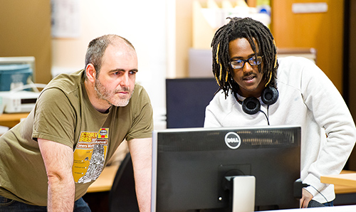 Student and employer observing a computer screen